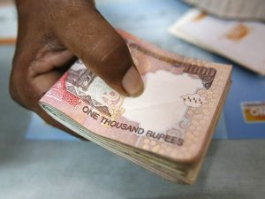 http://qz.com/830858/why-narendra-modis-move-to-ban-500-and-1000-indian-rupee-notes-is-such-a-big-deal-explained-in-one-chart/