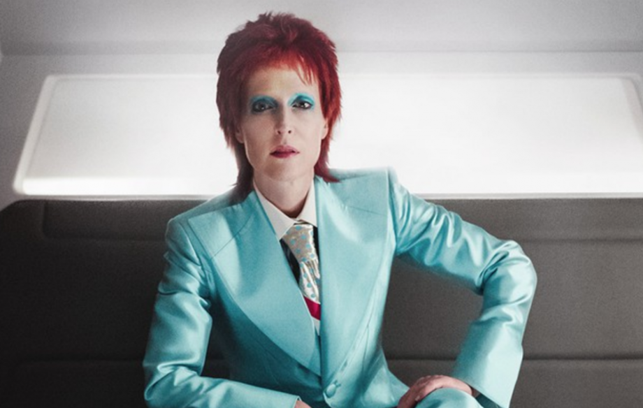 Gillian Anderson as Media portraying as David Bowie