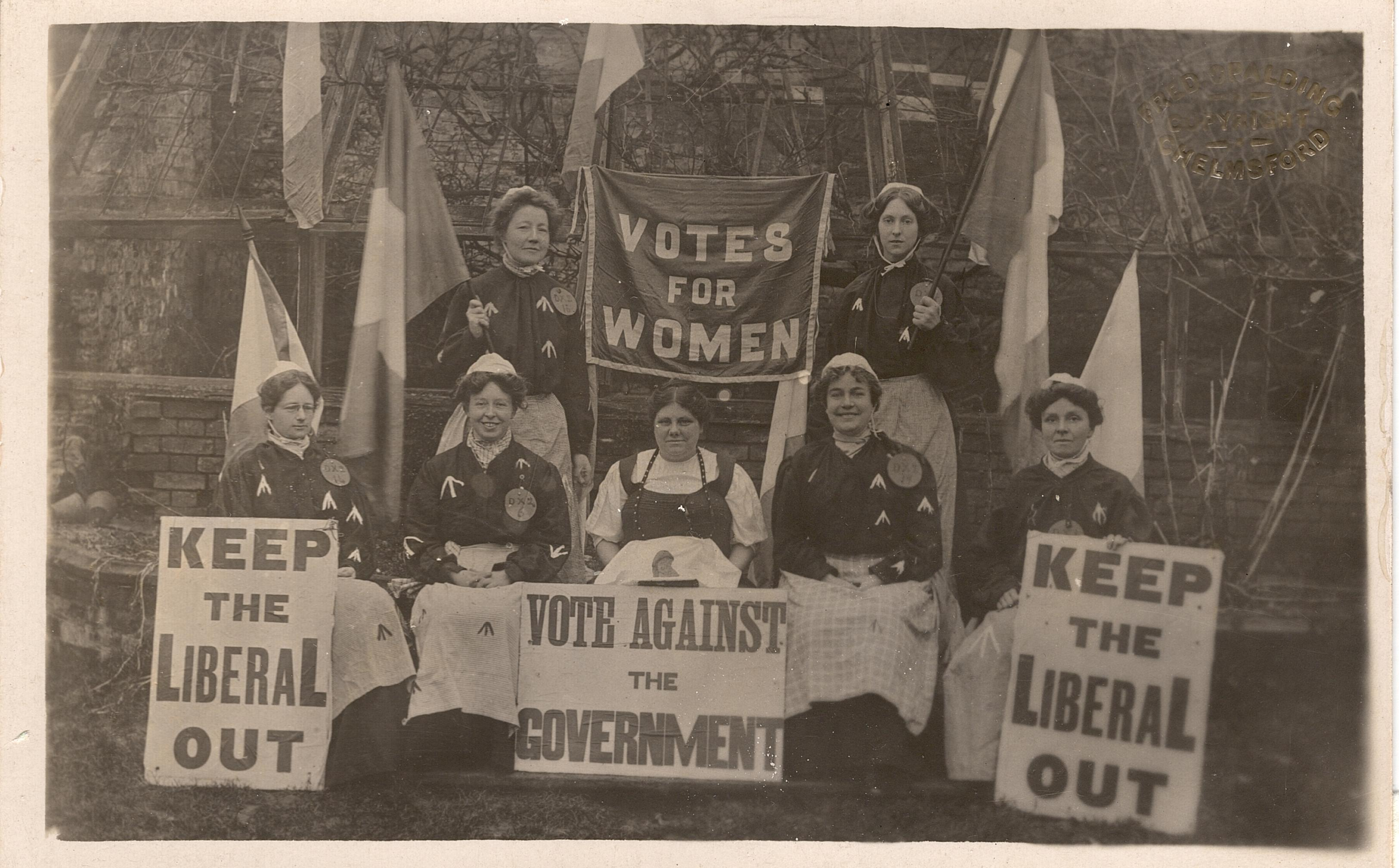 Suffragettes demonstrating at a by-election. Courtesy of LSE Library